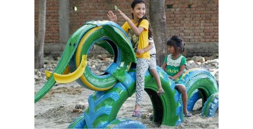 Architect reuses old tires and turns them into playgrounds