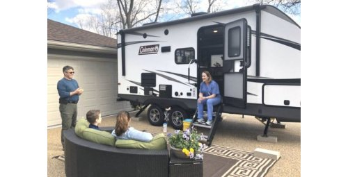 Doctor returns home after living 1 year in trailer to protect family